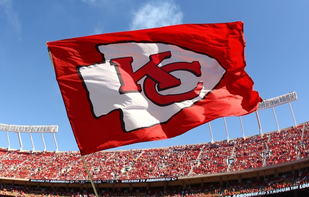 Chiefs flag waves in Arrowhead Stadium.