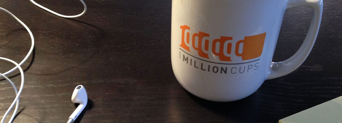 1 Million Cups logo with mug and heaphones