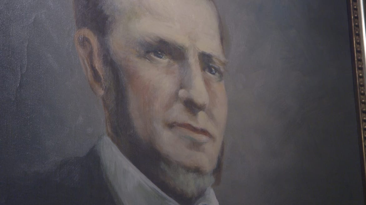 Close up picture of 1800s portrait of a man.