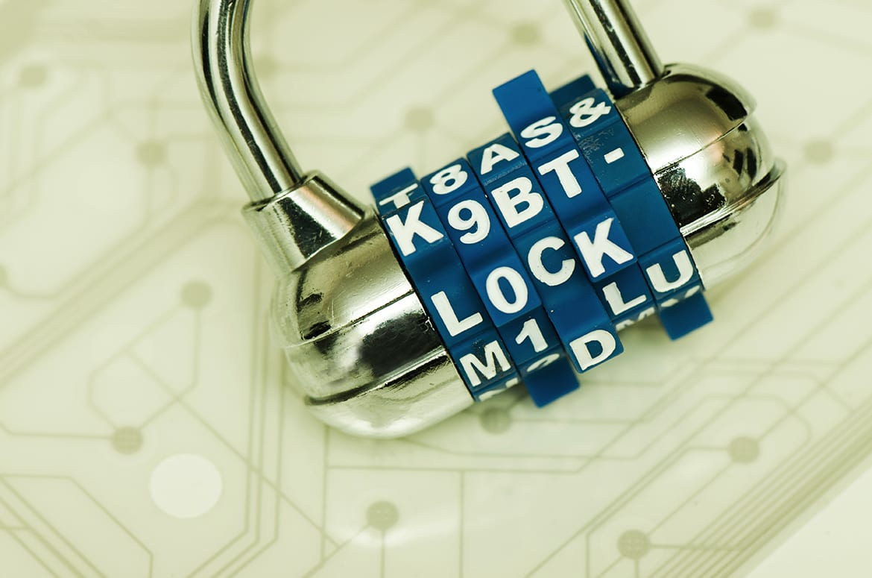 Photo of padlock on top of circuit board