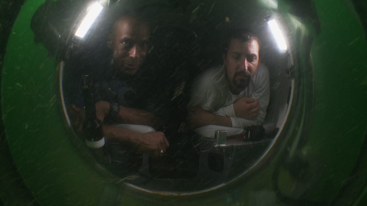 Image of Dr. Lewis and another man in a submarine.