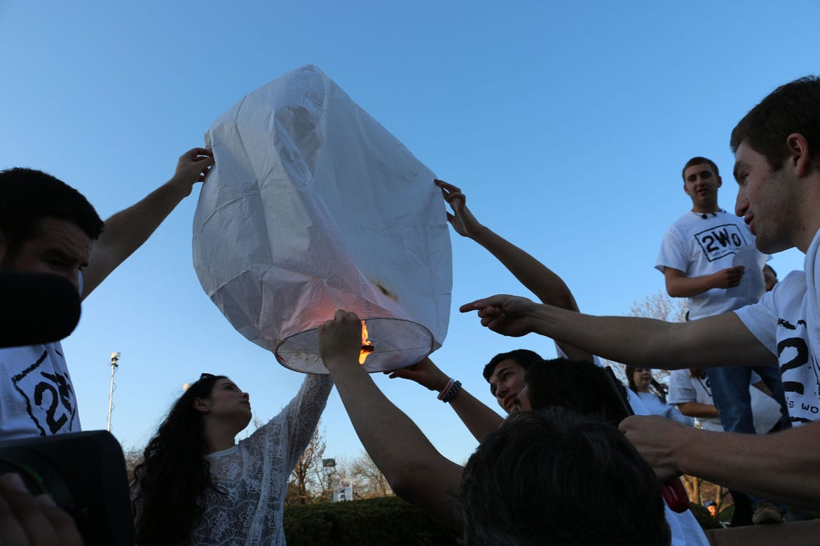Teens try to launch a lantern