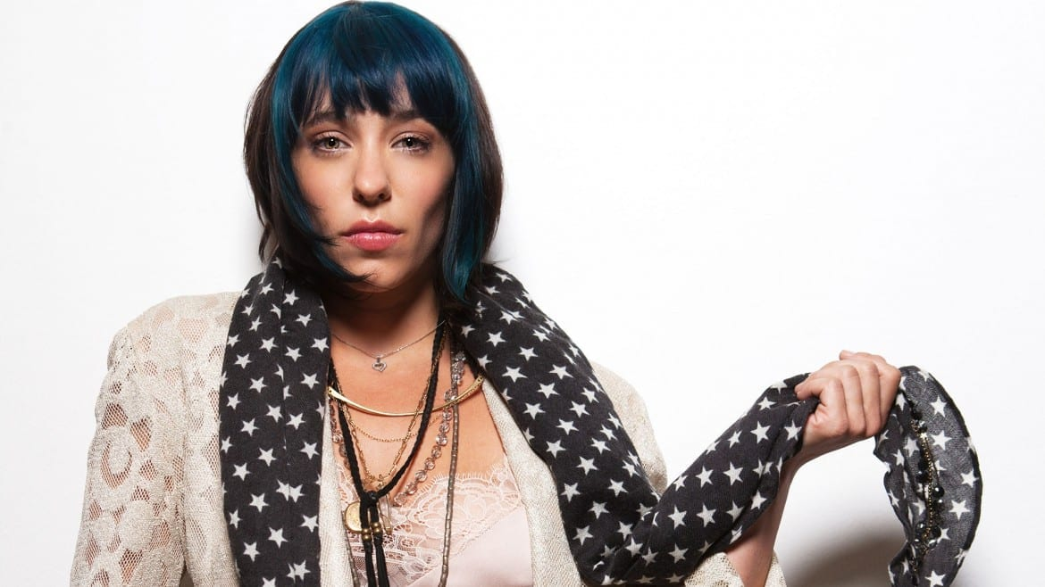 woman w/ blue and black hair poses for the camera