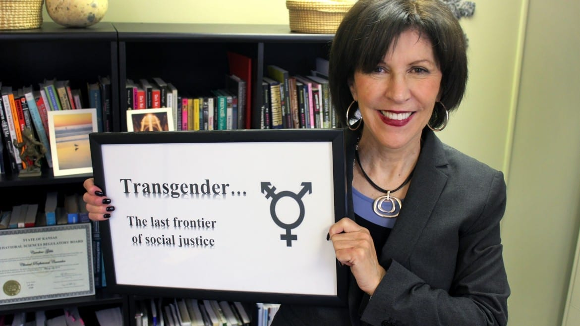 Image of woman holding a sign that says