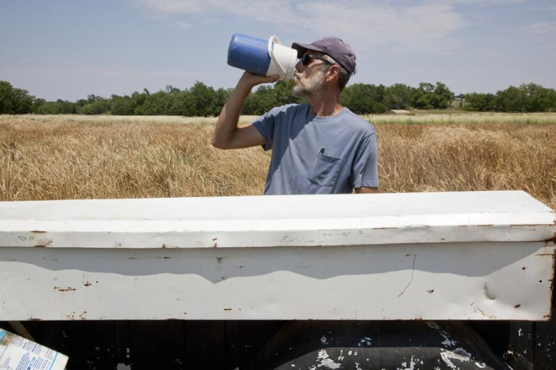 A man in Kansas takes a drink from a water container. While about 96 percent of Kansans receive water from public water supplies that meet or exceed all state and federal regulations for clean water, some public water systems have one of more sources that exceed safe levels of contaminants.