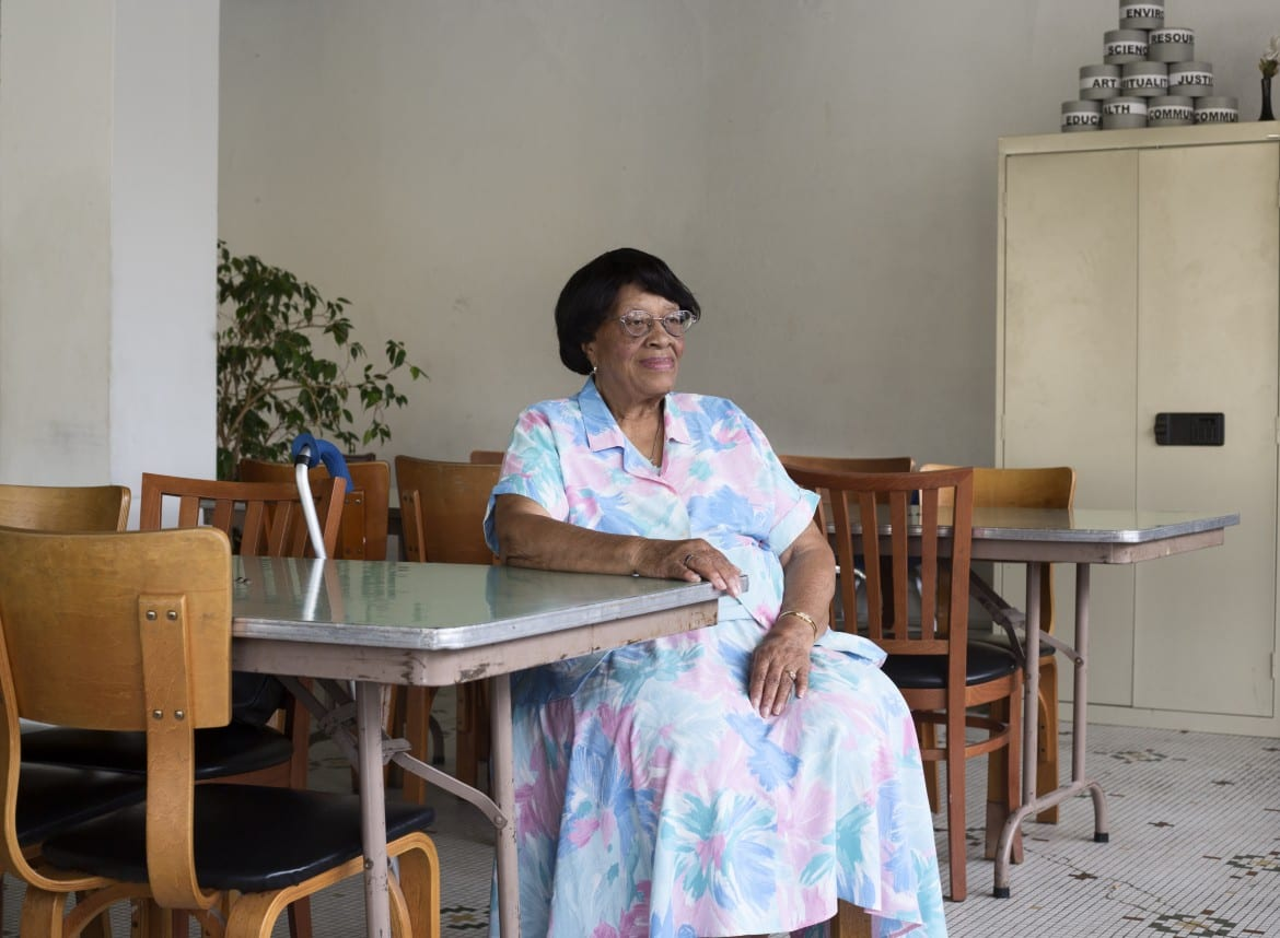 Mable Fuller sitting at a table.