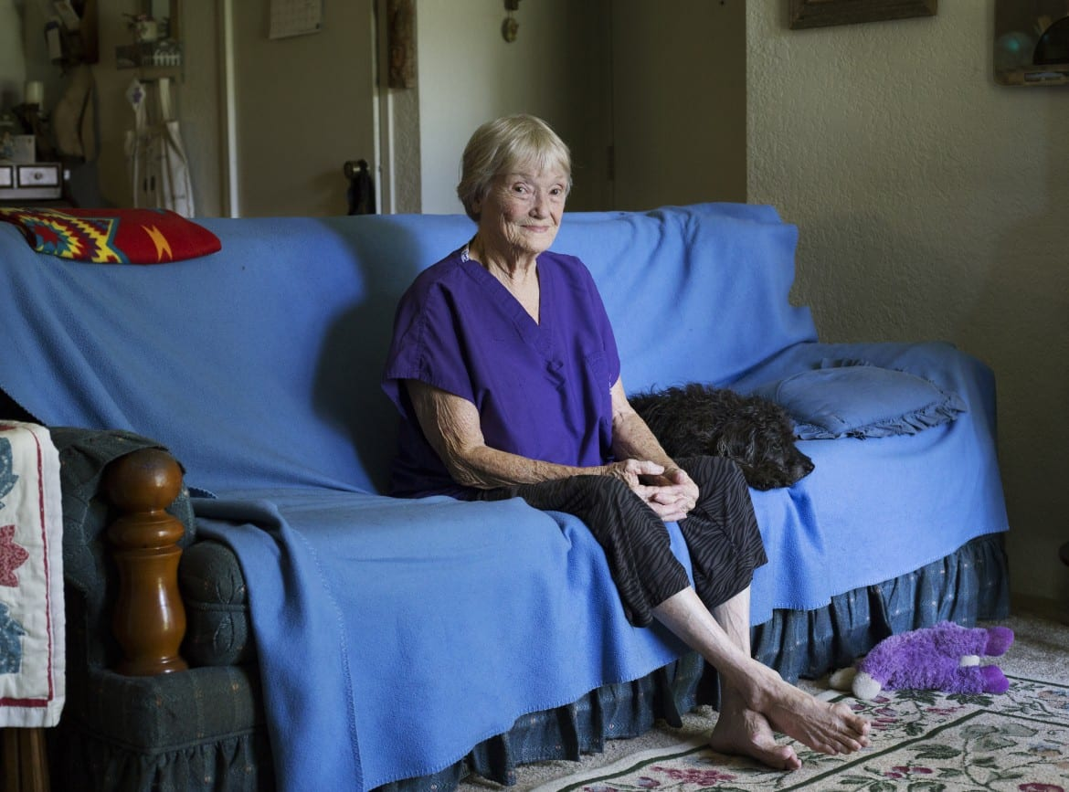 Patricia Corry sitting on her sofa