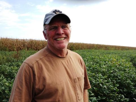 Fifth-generation farmer Richard Oswald stands in a field of soybeans that's worth a lot less than it would have been last year, partly thanks to a downturn in the economy of China. (Photo: Frank Morris | Harvest Public Media)