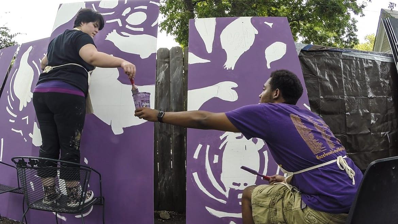 Kansas City Art Institute students work on a diversity-themed panel as part of a larger mural for Scarritt Elementary. (Photos: Julie Denesha | KCPT)
