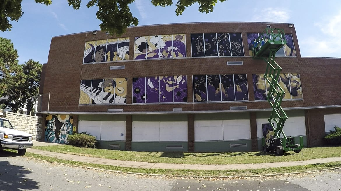 Art panels are installed on the abandoned building that housed Scarritt Elementary as part of a beautification project with the Kansas City Art Institute.