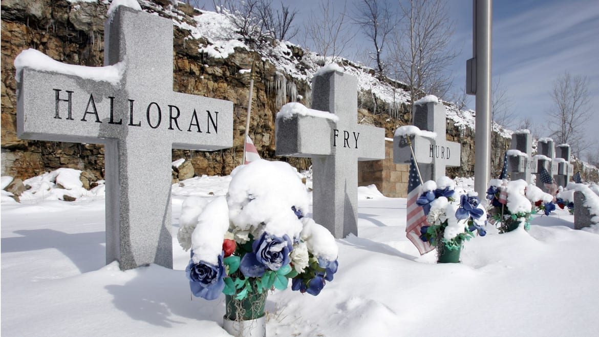 Graves of firefighters covered in snow