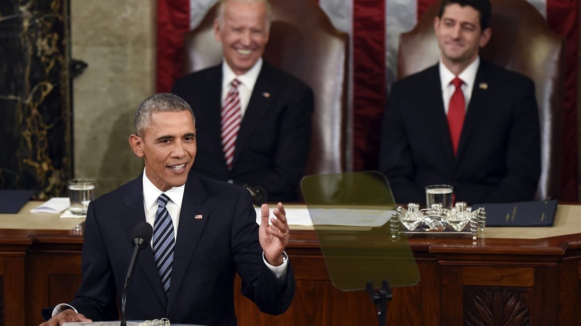 Vice President Joe Biden and House Speaker Paul Ryan of Wis., listen as President Barack Obama gives his State of the Union address to a joint session of Congress on Capitol Hill in Washington on Tuesday. (Photo: Susan Walsh   AP)