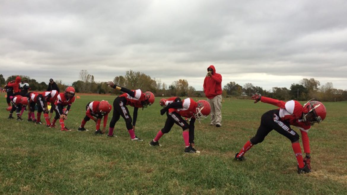 The KC United league plays weekly games in an empty field next to a church in western Kansas City, Kansas. (Photo: Alex Smith | Heartland Health Monitor)