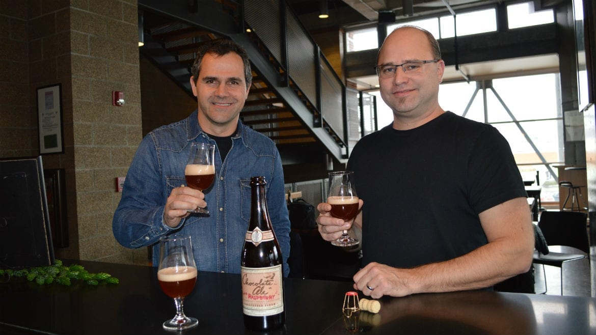 Boulevard brewmaster Steven Pauwels and chocolatier Christopher Elbow toast their latest collaboration: Chocolate Ale with Raspberry. (Photo: Jonathan Bender | Flatland)