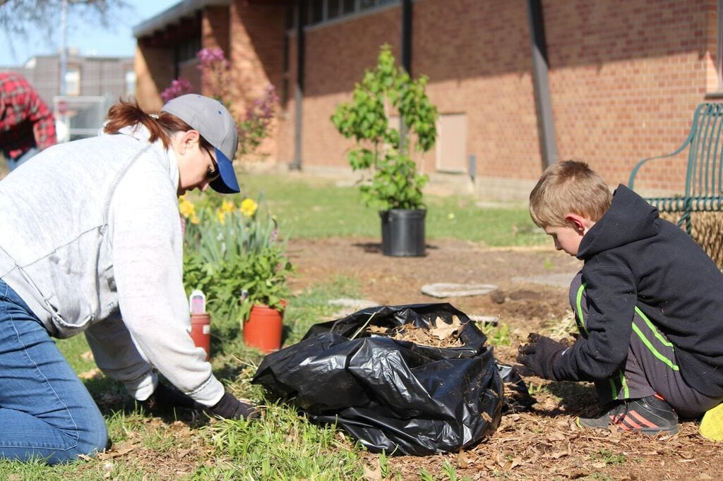 Volunteers digging in the ground