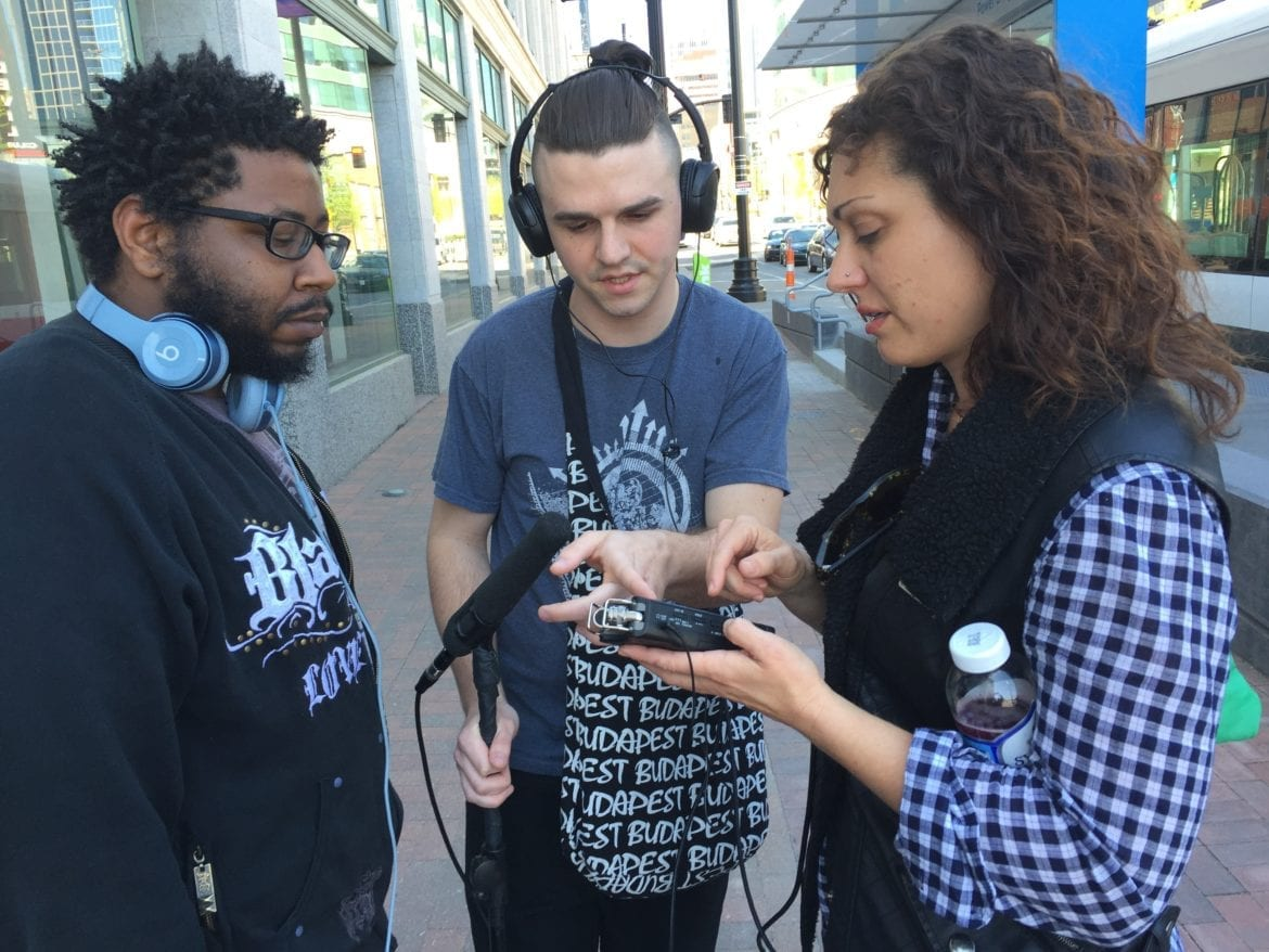 Three filmmakers talking on the street