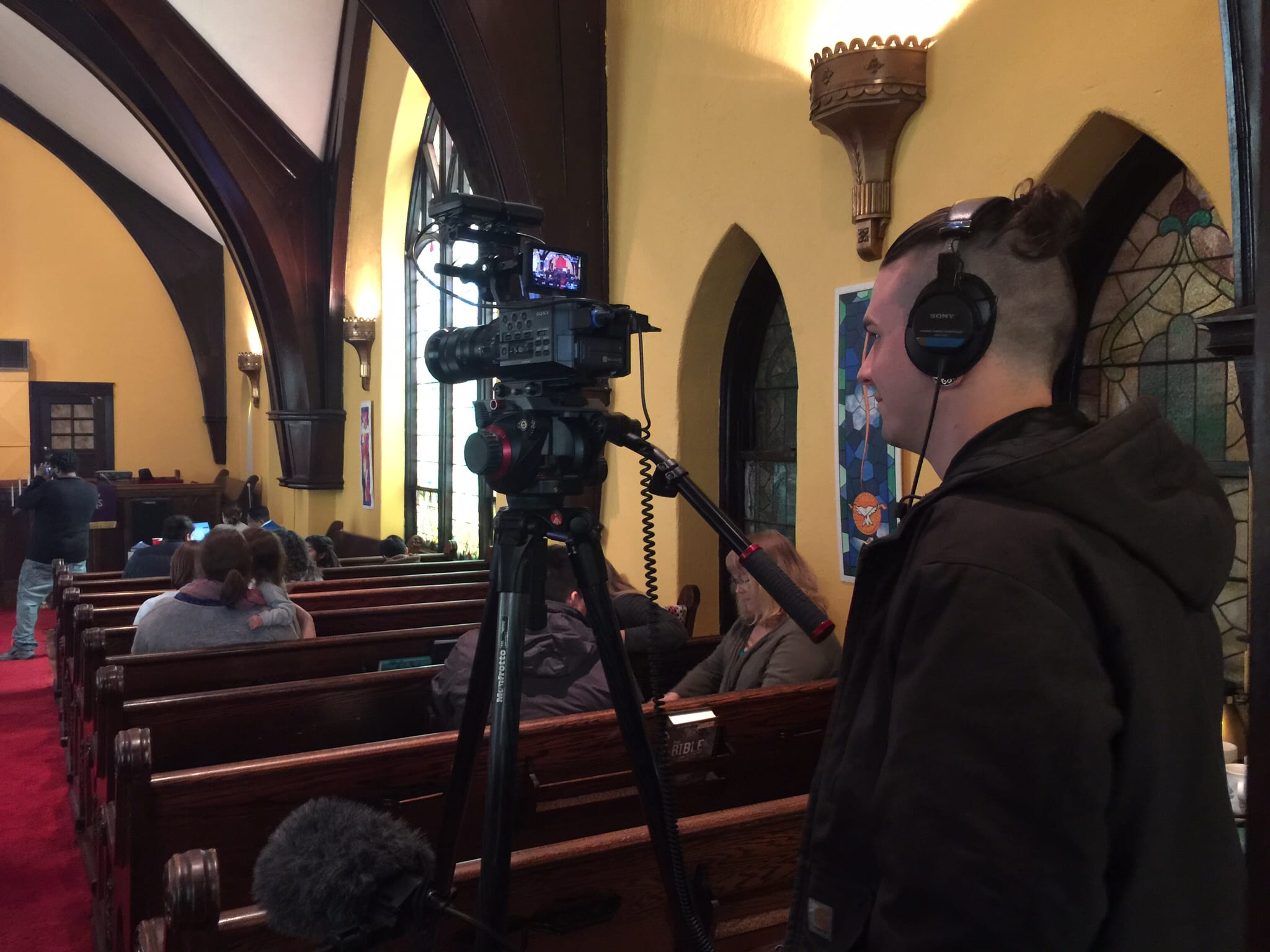 A cameraman in a church