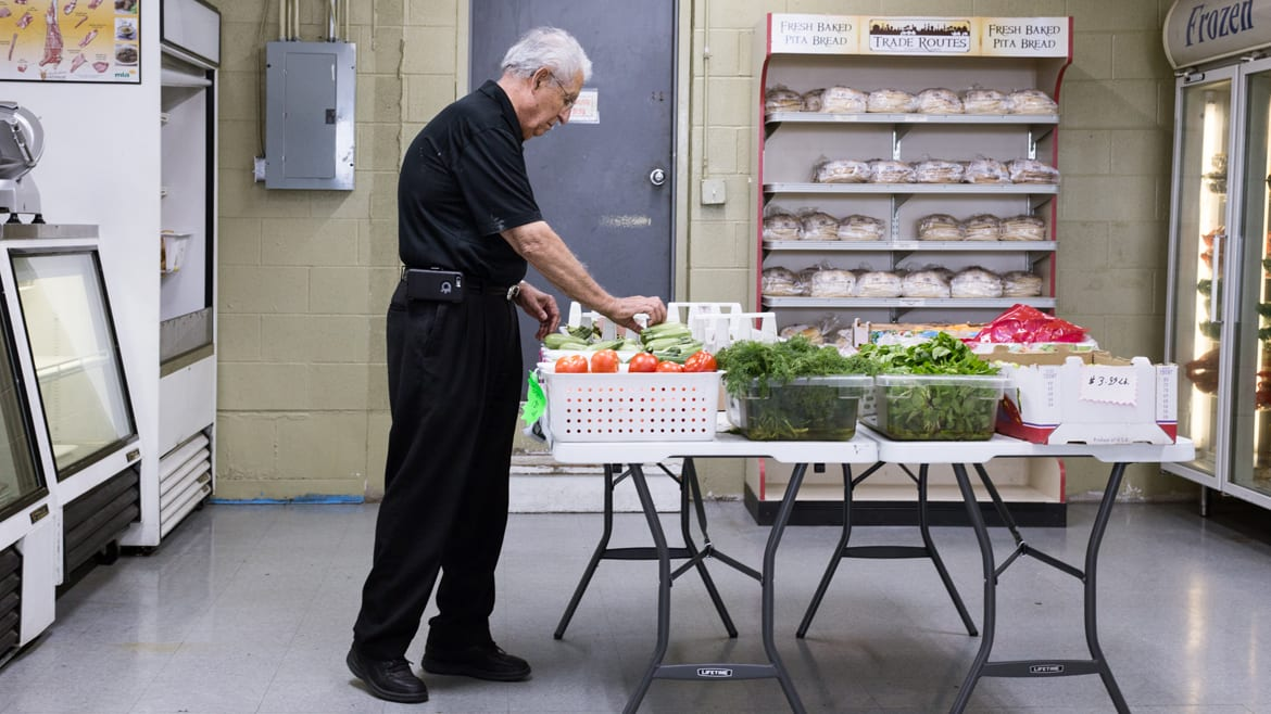 A man with fresh vegetables
