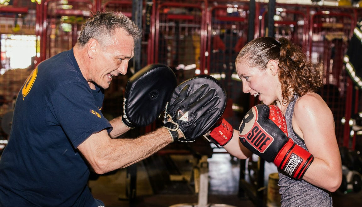 Fitzwater spars with her trainer.