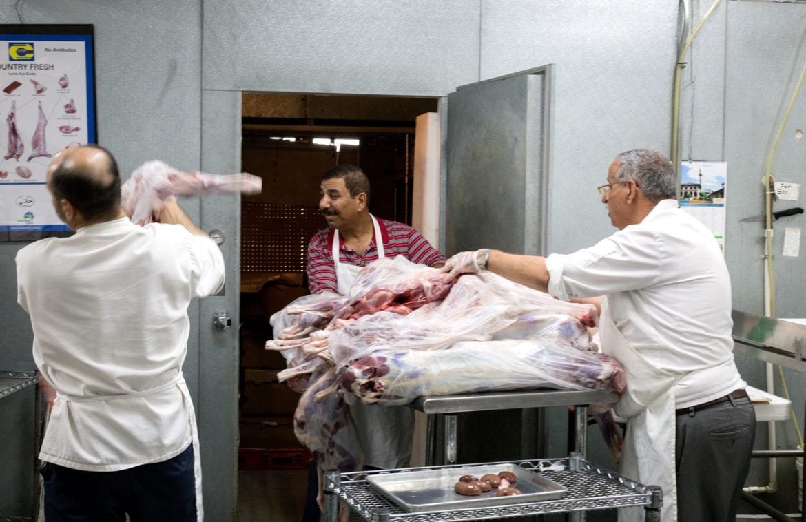 Butchers with meat