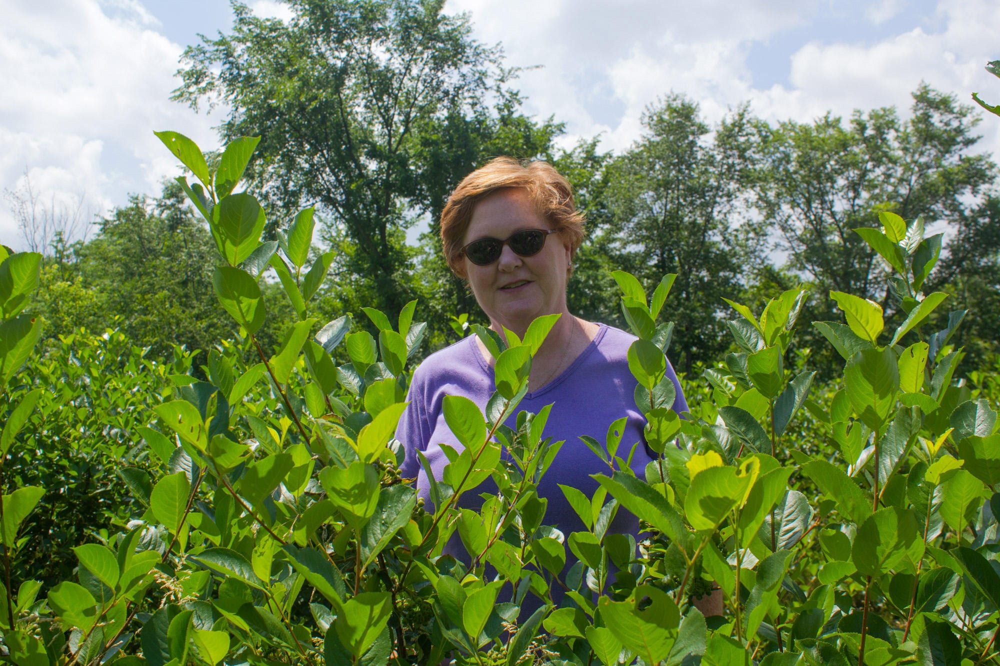Peggy Fogle stands in her garden.