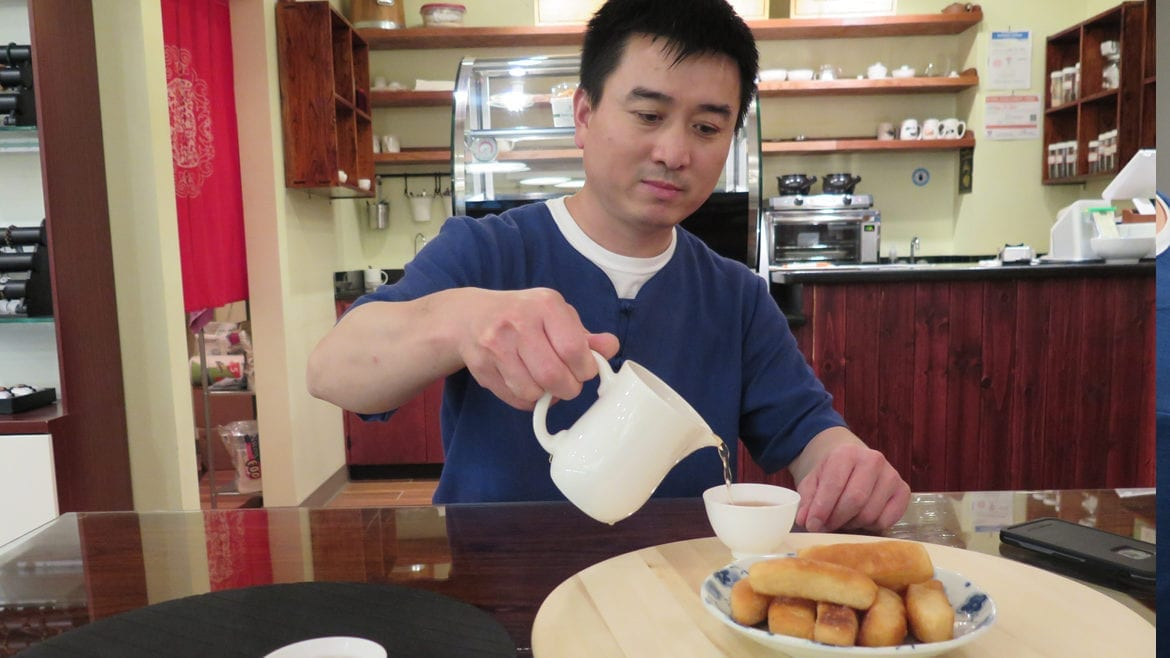 Pouring tea with sweet bread.