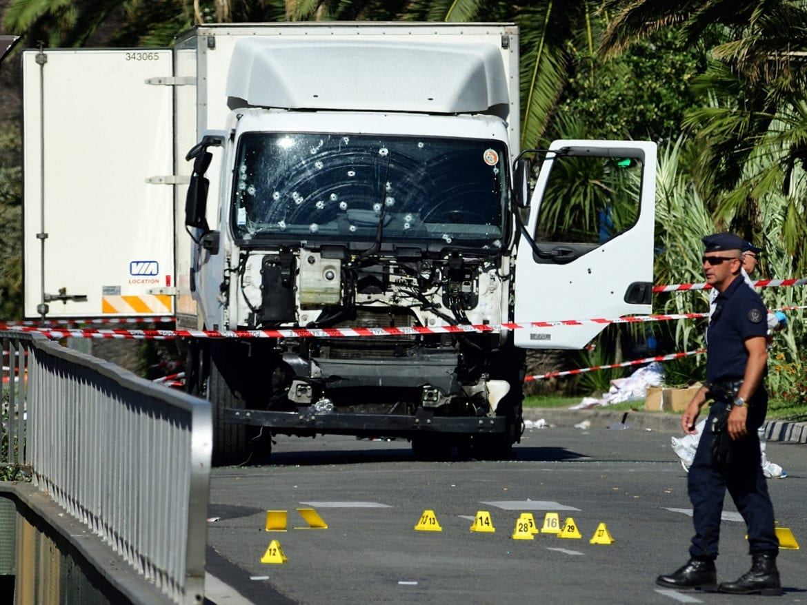 A truck with bullet holes.
