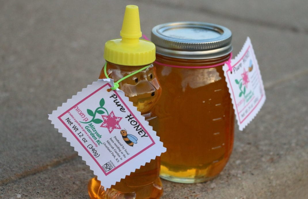 a bottle and jar of the honey produced at the garden