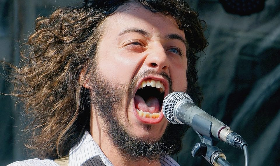 A man screaming into a microphone.
