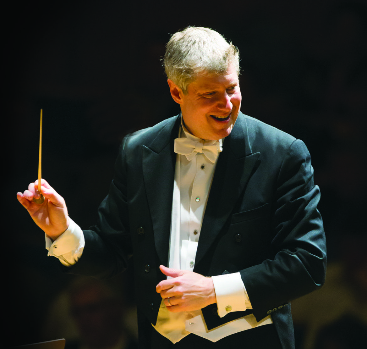 a man conducting an orchestra.