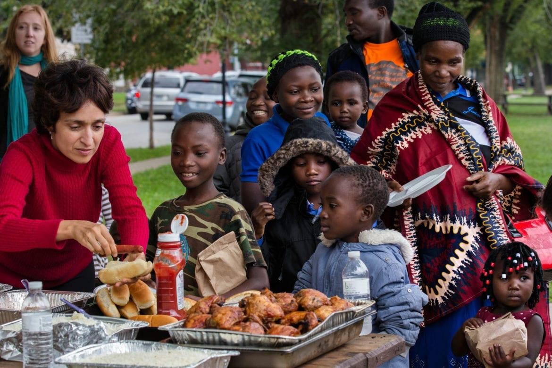 A volunteer helps a Tanzanian family