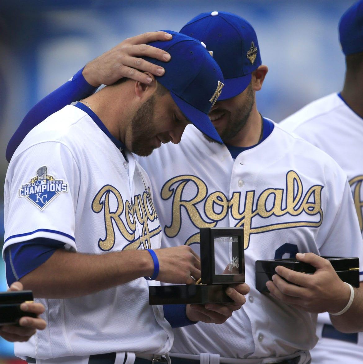 Baseball players looking at their world series rings