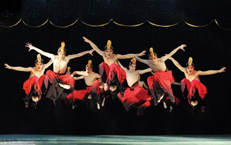Acrobats jumping.
