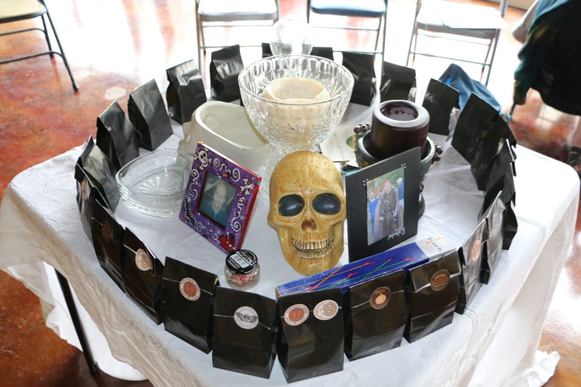 An altar with photos and candles.