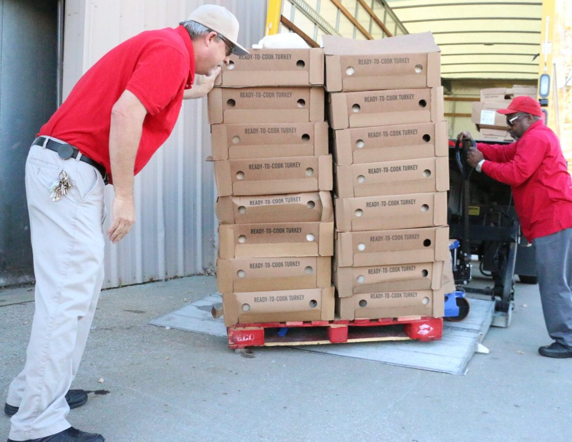 Salvation Army workers loading turkey on to a truck for transport to be cooked
