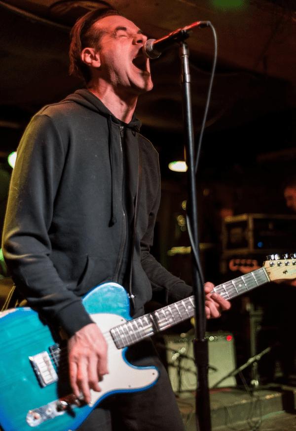 Lead singer of hipshot killers on guitar