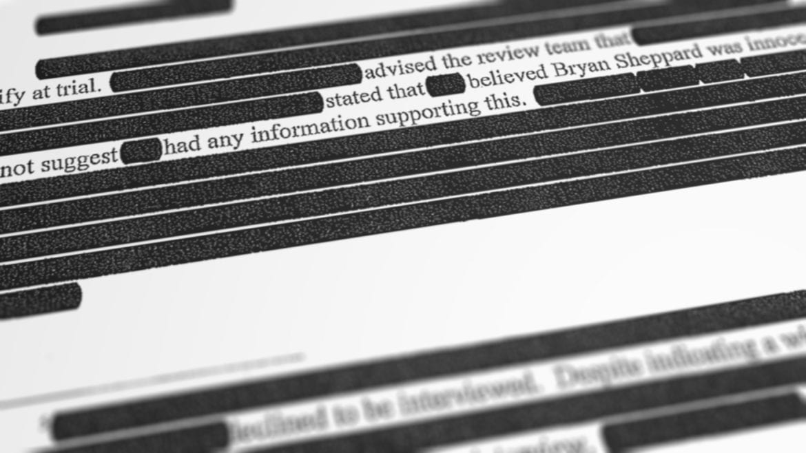 a portion of a heavily redacted report