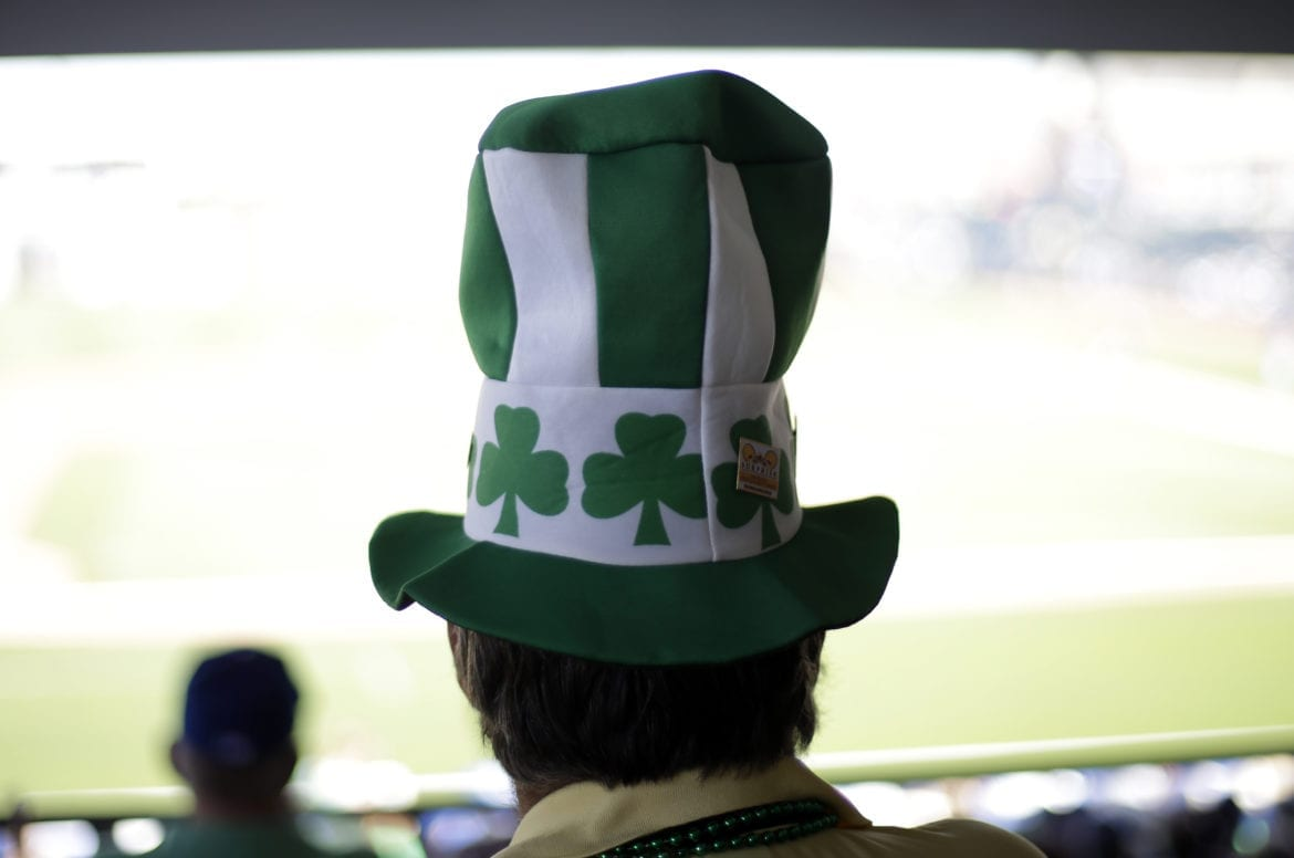 a man in a shamrock hat