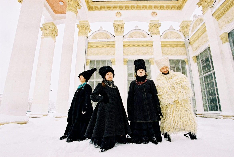 Four individuals dressed in traditional Ukrainian wardrobe.