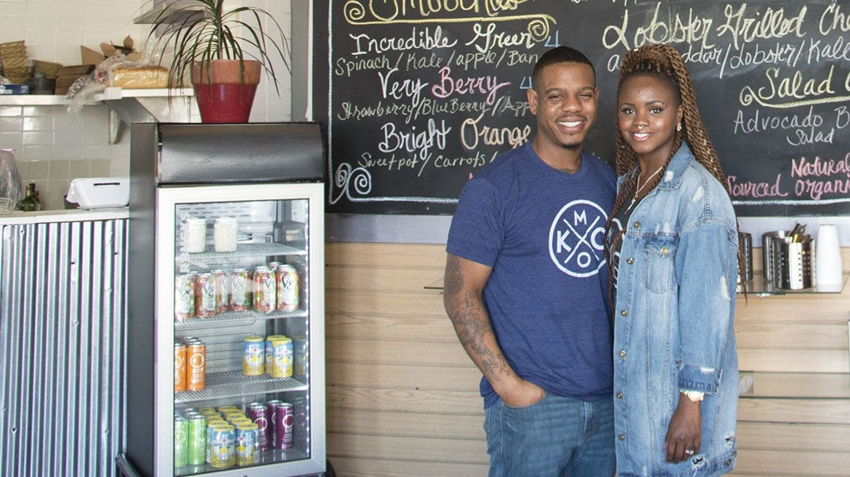Justin and Rashaun Clark stand next to their menu at Urban Café.