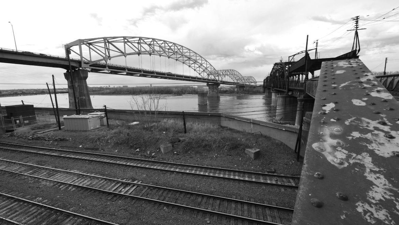 The Buck O'Niel Bridge, left, and Second Hannibal Bridge, right, span the Missouri River.