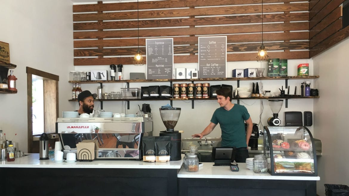 two baristas in a coffee shop