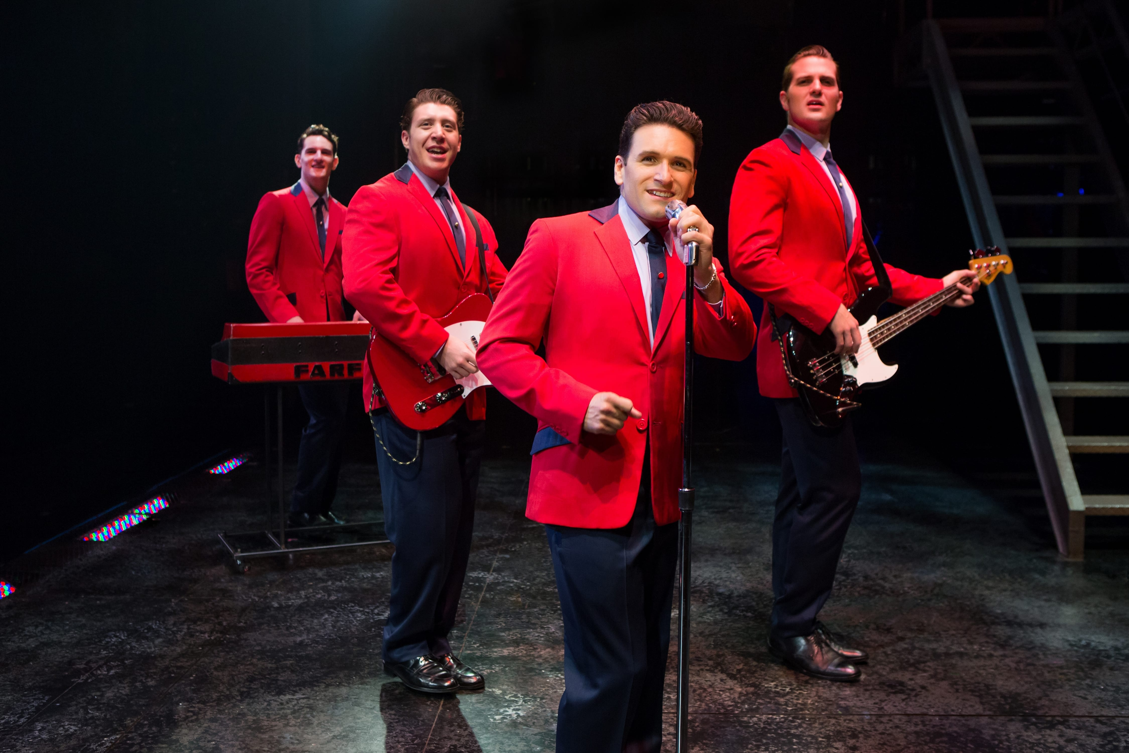 A quartet in red jackets.