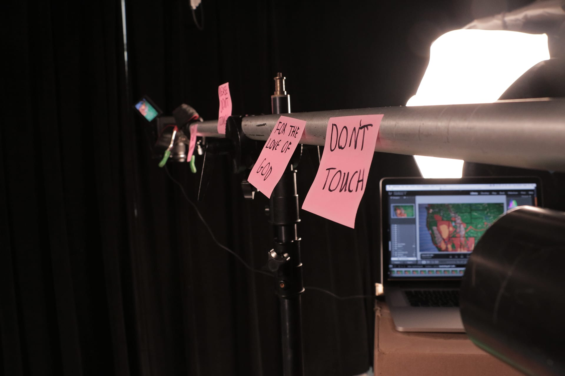 Sticky-notes on the camera arm pleading to not be touched.