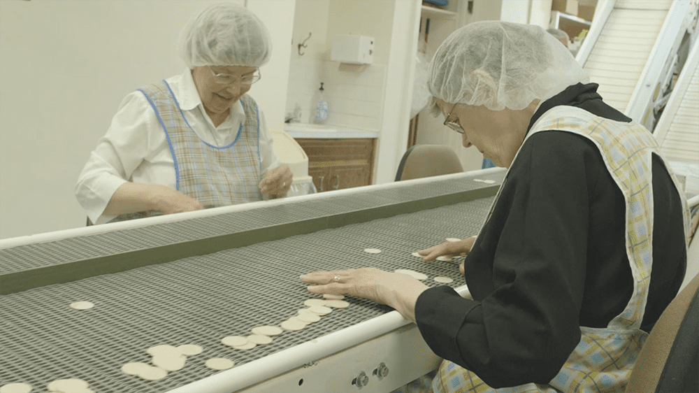 sisters perform quality control on the altar bread