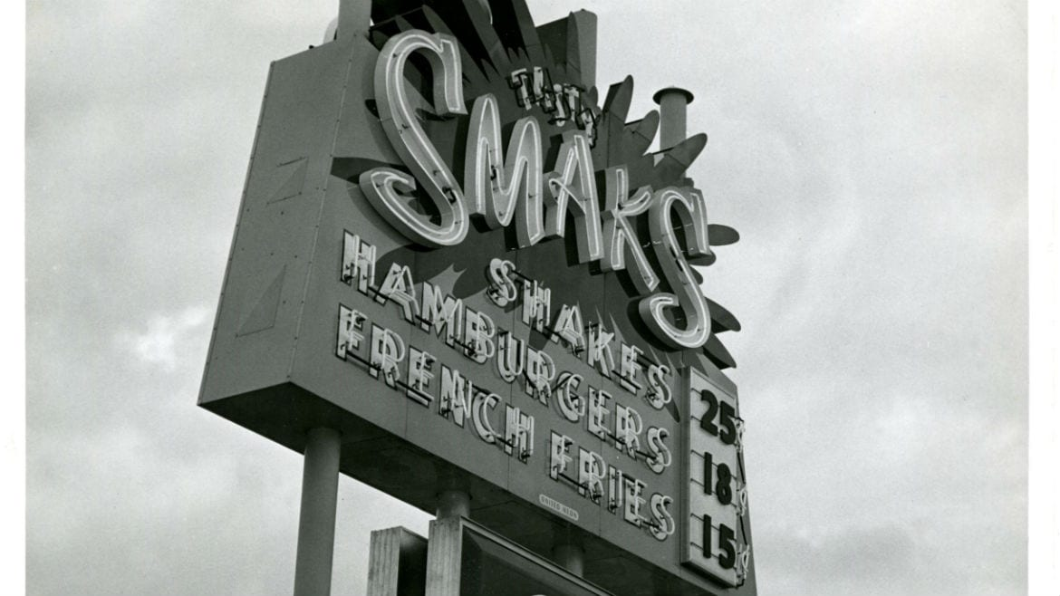 The Smaks sign