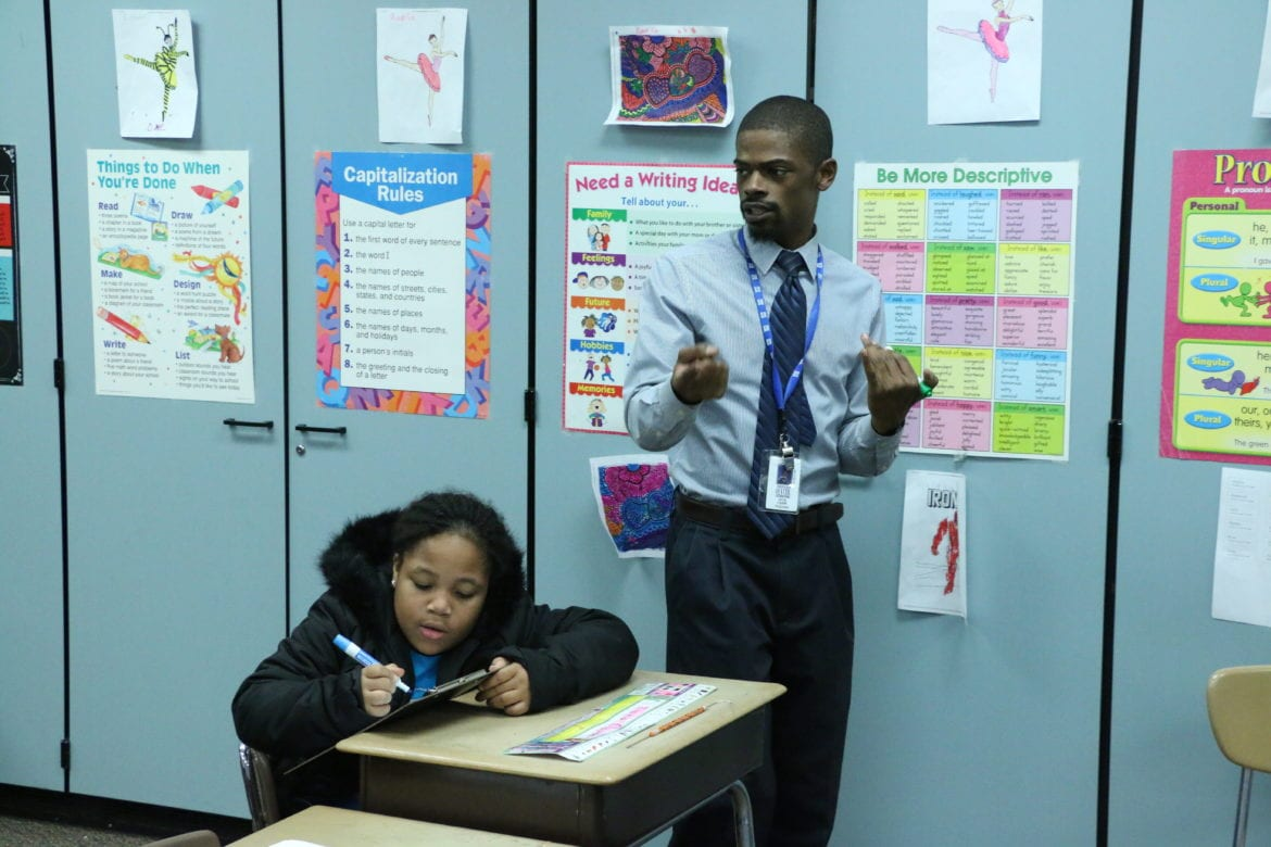 curiousKC a teacher and his student at Center high school