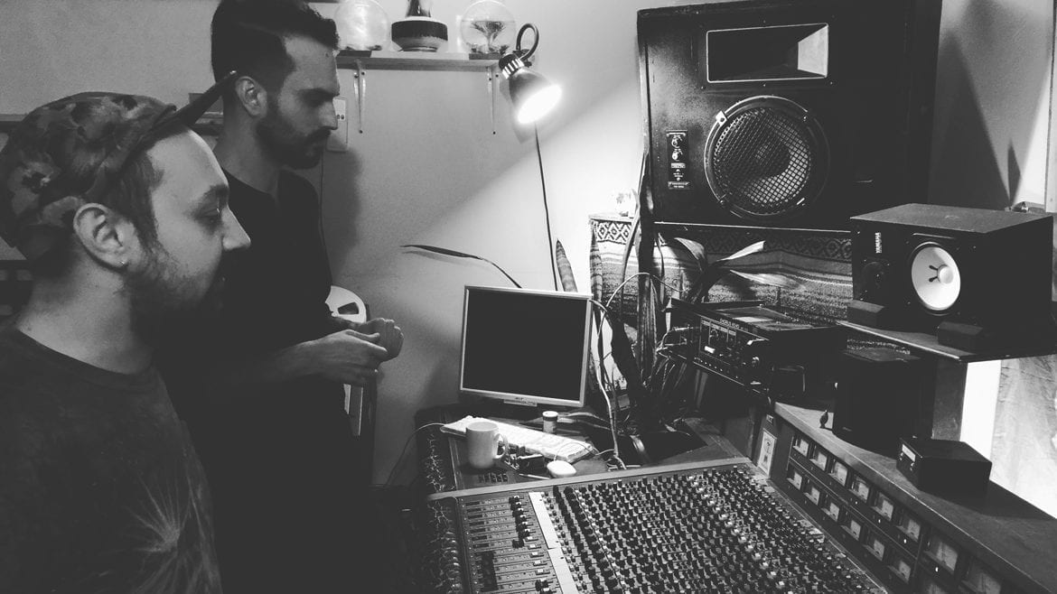 Musician and sound engineer at mixing board