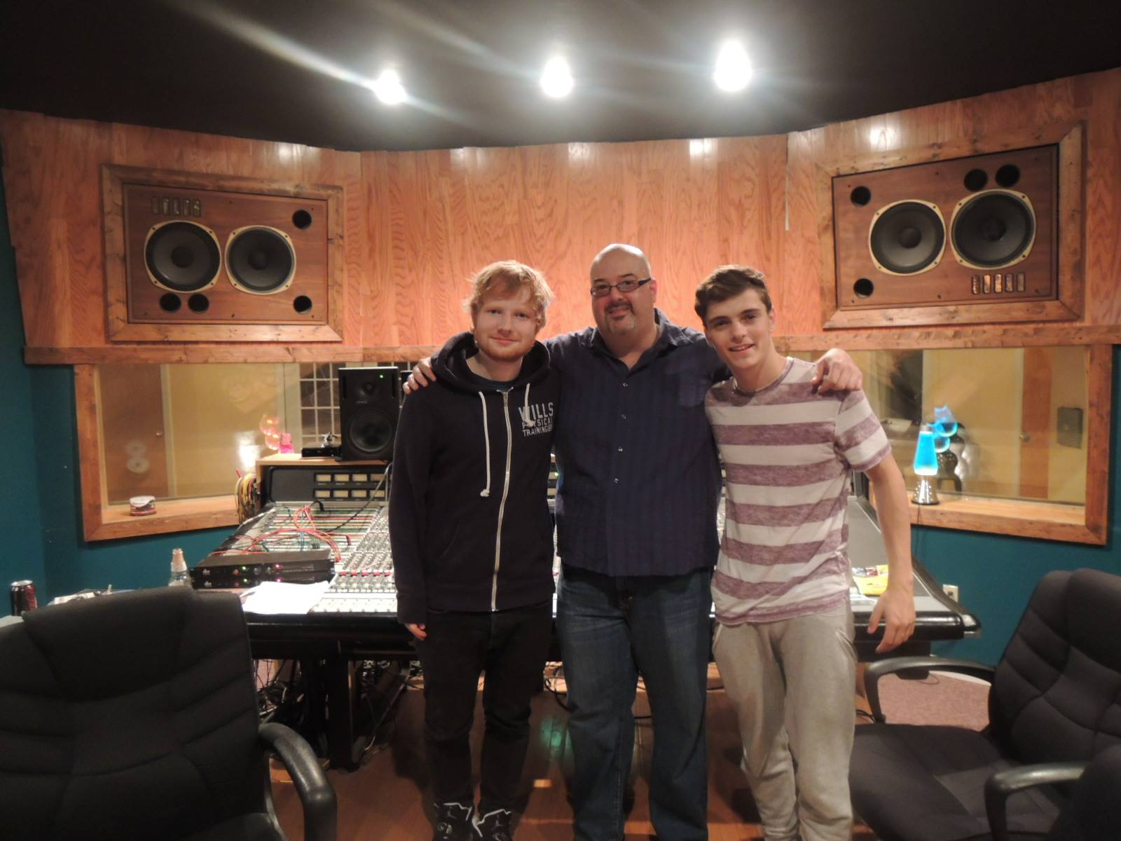 Three men in a recording studio