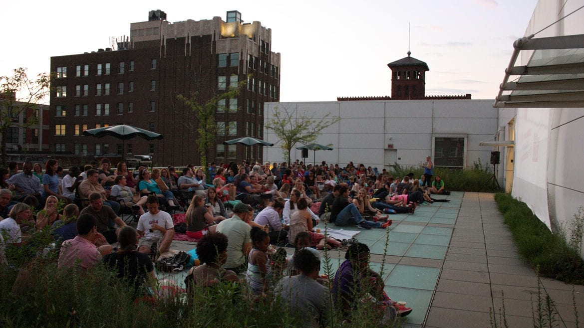 Movie-goers on top of Kansas City Public Library downtown central library for Off the Wall film festival